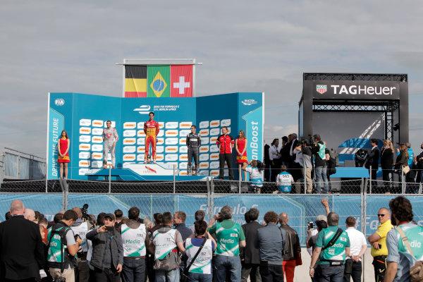 2014/2015 FIA Formula E Championship. Berlin ePrix, Berlin Tempelhof Airport, Germany. Saturday 23 May 2015 Podium. 1st, Lucas di Grassi (BRA)/Audi Abt Sport - Spark-Renault SRT_01E, 2nd, Jerome D'Ambrosio (BEL)/Dragon Racing - Spark-Renault SRT_01E and 3rd, Sebastien Buemi (SWI)/E.dams Renault - Spark-Renault SRT_01E. Photo: Andrew Ferraro/LAT/Formula E ref: Digital Image _MG_7617