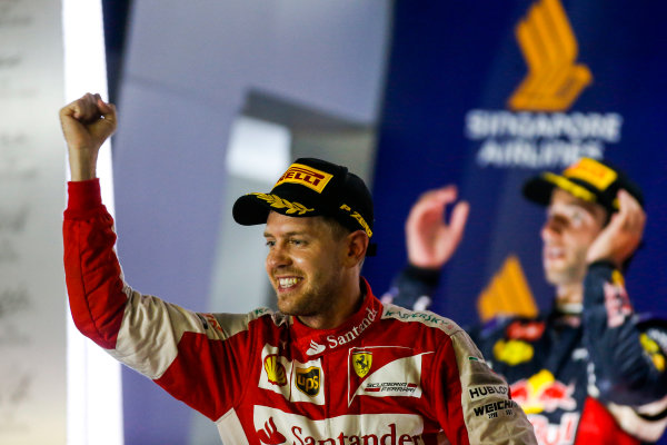 Marina Bay Circuit, Singapore. Sunday 20 September 2015. Sebastian Vettel, Ferrari, 1st Position, celebrates on the podium. World Copyright: Glenn Dunbar/LAT Photographic. ref: Digital Image _89P5961