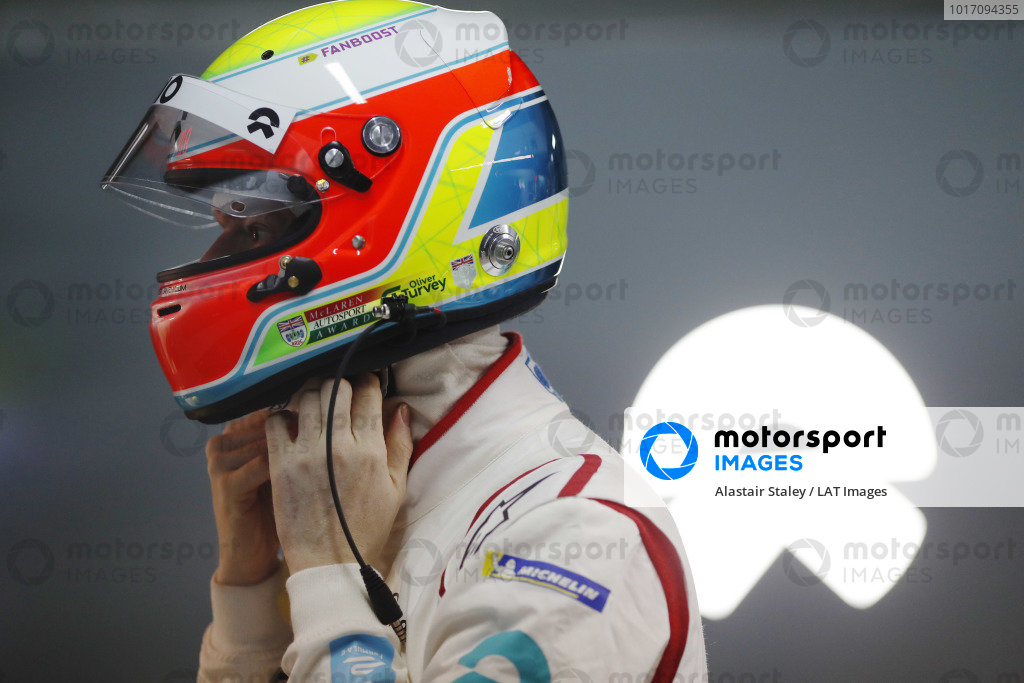 Oliver Turvey (GBR), NIO Formula E Team, puts on his helmet in the garage