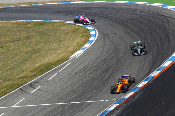 Fernando Alonso, McLaren MCL33 Renault, leads Lewis Hamilton, Mercedes AMG F1 W09, and Esteban Ocon, Force India VJM11 Mercedes.