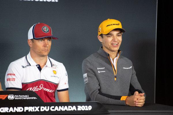 Kimi Raikkonen, Alfa Romeo Racing, and Lando Norris, McLaren