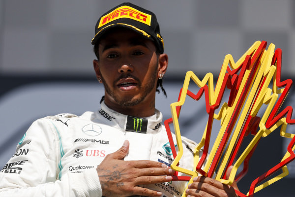 Lewis Hamilton, Mercedes AMG F1 celebrates on the podium with the trophy