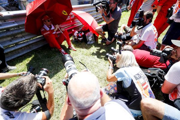 Media around Charles Leclerc, Ferrari on the grid