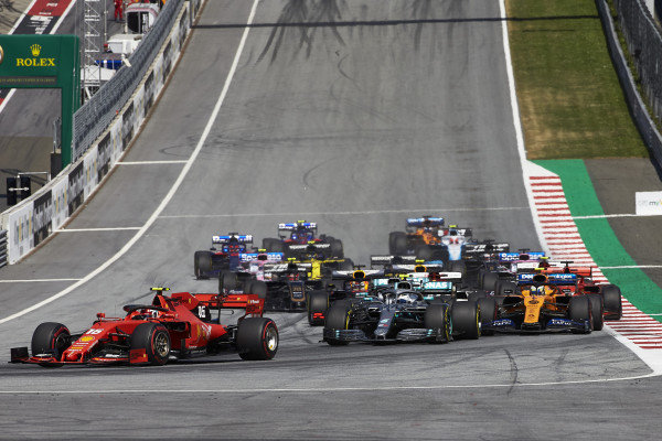Charles Leclerc, Ferrari SF90, leads Valtteri Bottas, Mercedes AMG W10, Lewis Hamilton, Mercedes AMG F1 W10, Lando Norris, McLaren MCL34, Kimi Raikkonen, Alfa Romeo Racing C38, and the rest of the field at the start