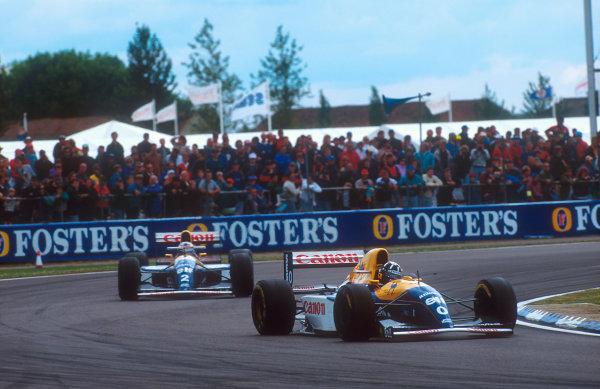 1993 British Grand Prix.Silverstone, England.9-11 July 1993.Damon Hill leads Alain Prost (both Williams FW15C Renault's).Ref-93 GB 04.World Copyright - LAT Photographic