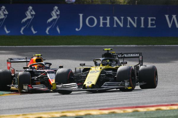 Nico Hulkenberg, Renault R.S. 19, leads Alexander Albon, Red Bull RB15