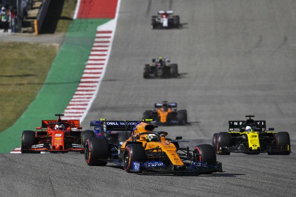 Lando Norris, McLaren MCL34, leads Sebastian Vettel, Ferrari SF90, Daniel Ricciardo, Renault R.S.19, Carlos Sainz Jr., McLaren MCL34, and Kevin Magnussen, Haas VF-19