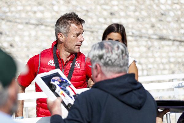 Sebastien Loeb passes autograph hunters