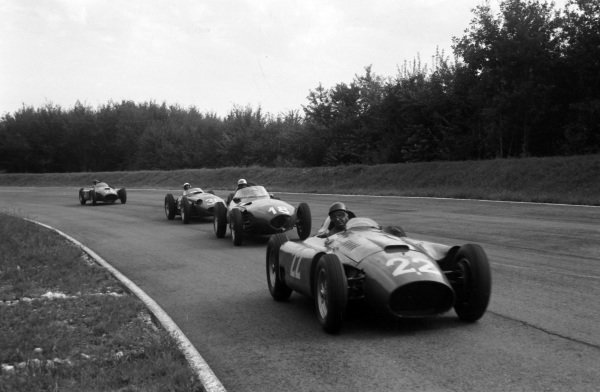 Juan Manuel Fangio/Eugenio Castellotti, Ferrari D50, leads Harry Schell, Vanwall, Stirling Moss, Maserati 250F, and Peter Collins/Juan Manuel Fangio, Ferrari D50.