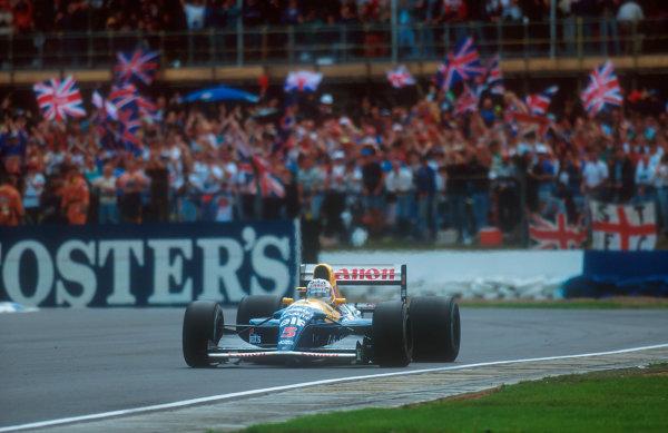 1992 British Grand Prix.Silverstone, England.10-12 July 1992.Nigel Mansell (Williams FW14B Renault) 1st position.Ref-92 GB 07.World Copyright - LAT Photographic