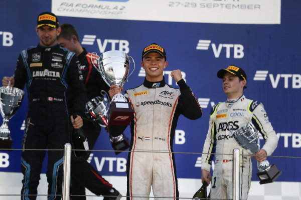 SOCHI AUTODROM, RUSSIAN FEDERATION - SEPTEMBER 28: Nyck De Vries (NLD, ART GRAND PRIX), celebrates winning the drivers' title on the podium with Nicholas Latifi (CAN, DAMS) and Louis Deletraz (CHE, CARLIN) during the Sochi at Sochi Autodrom on September 28, 2019 in Sochi Autodrom, Russian Federation. (Photo by Joe Portlock / LAT Images / FIA F2 Championship)