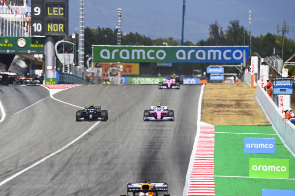 Max Verstappen, Red Bull Racing RB16, leads Valtteri Bottas, Mercedes F1 W11 EQ Performance, and Lance Stroll, Racing Point RP20
