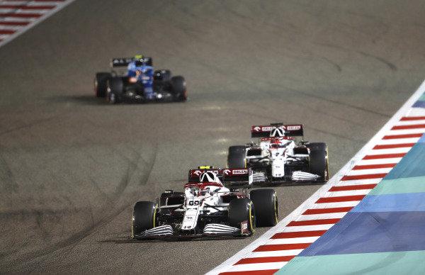 Antonio Giovinazzi, Alfa Romeo Racing C41, leads Kimi Raikkonen, Alfa Romeo Racing C41, and Esteban Ocon, Alpine A521