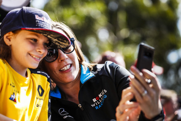 Claire Williams, Deputy Team Principal, Williams Racing poses for a selfie with a fan.