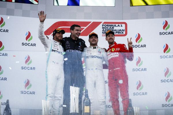 Lewis Hamilton, Mercedes AMG F1, Race Winner Valtteri Bottas, Mercedes AMG F1 and Sebastian Vettel, Ferrari celebrate on the podium