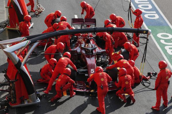 Sebastian Vettel, Ferrari SF1000, makes a stop