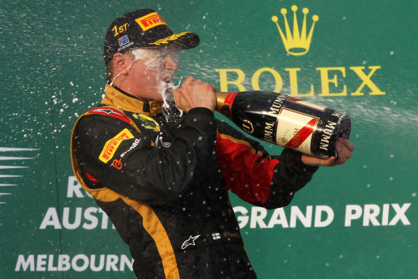 Race winner Kimi Raikkonen (FIN) Lotus F1 celebrates with the champagne on the podium. Formula One World Championship, Rd1, Australian Grand Prix, Race, Albert Park, Melbourne, Australia, Sunday 17 March 2013.  BEST IMAGE