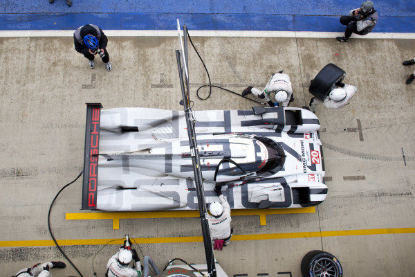 Timo Bernhard (GER) / Mark Webber (AUS) / Brendon Hartley (NZL) Porsche 919 Hybrid makes a pit stop. World Endurance Championship, Rd1, Silverstone, England, 18-20 April 2014.