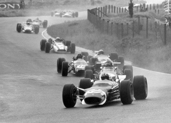 1968 Dutch Grand Prix.Zandvoort, Holland. 23 June 1968.Jo Siffert, Lotus 49-Ford, retired, leads Jochen Rindt, Brabham BT26-Repco, retired, Dan Gurney, Brabham BT24-Repco, retired, Bruce McLaren, McLaren M7A-Ford, retired, and John Surtees, Honda RA301, retired, action.World Copyright: LAT PhotographicRef: b&w print
