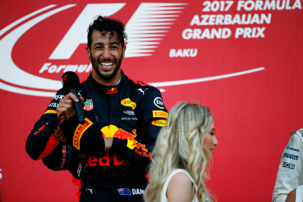 Baku City Circuit, Baku, Azerbaijan. Sunday 25 June 2017. Daniel Ricciardo, Red Bull Racing, celebrates victory on the podium. World Copyright: Andy Hone/LAT Images ref: Digital Image _ONY9154