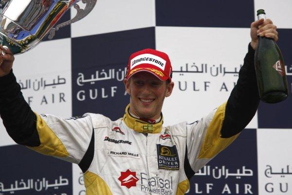 2008 GP2 Asia Series. Saturday Race.Bahrain International Circuit. Sakhir, Bahrain. 5th April. Romain Grosjean (FRA, ART Grand Prix) celebrates victory on the podium. World Copyright: Andrew Ferraro/GP2 Series Media Service. Service ref:__H0Y2694 jpg