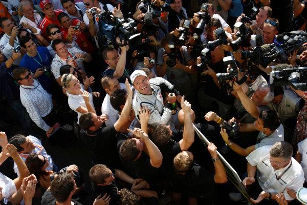 Autodromo Nazionale di Monza, Monza, Italy. 13th September 2009. Rubens Barrichello, Brawn GP BGP001 Mercedes, 1st position, celebrates with the Brawn GP team. Portrait. World Copyright: Andrew Ferraro/LAT Photographic ref: Digital Image _H0Y4815