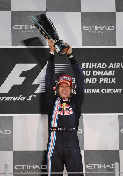 Yas Marina Circuit, Abu Dhabi, United Arab Emirates 1st November 2009. Sebastian Vettel, Red Bull Racing RB5 Renault, 1st position, celebrates victory on the podium. Portrait. Podium.  World Copyright: Steve Etherington/LAT Photographic ref: Digital Image SNE17965