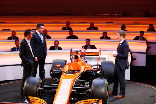 McLaren MCL32 Honda Formula 1 Launch. McLaren Technology Centre, Woking, UK. Friday 24 February 2017. Yusuke Hasegawa, Senior Managing Officer, Honda, Eric Boullier, Racing Director, McLaren, and presenter Simon Lazenby stand on stage next to the MCL32. World Copyright: Steven Tee/LAT Images Ref: _O3I4982