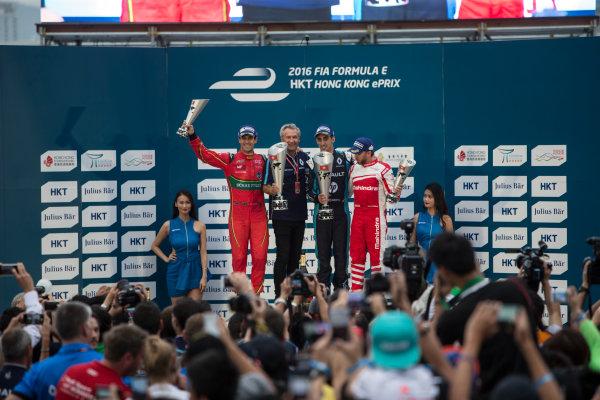 2016/2017 FIA Formula E Championship. Hong Kong ePrix, Hong Kong, China. Sunday 9 October 2016. Lucas Di Grassi (BRA), ABT Schaeffler Audi Sport, Spark-Abt Sportsline, ABT Schaeffler FE02, Sebastien Buemi (SUI), Renault e.Dams, Spark-Renault, Renault Z.E 16 and Nick Heidfeld (GER), Mahindra Racing, Spark-Mahindra, Mahindra M3ELECTRO on the podium. Photo: Andrew Ferraro/LAT/Formula E ref: Digital Image _FER2517