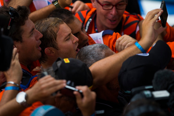 Autodromo Nazionale di Monza, Italy. Sunday 4 September 2016. Nico Rosberg, Mercedes AMG, 1st Position, celebrates and take a picture with the marshals. World Copyright: Sam Bloxham/LAT Photographic ref: Digital Image _SLA8851