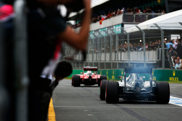 Albert Park, Melbourne, Australia. Saturday 19 March 2016. Kimi Raikkonen, Ferrari SF16-H, leads Lewis Hamilton, Mercedes F1 W07 Hybrid, out of the pits. World Copyright: Sam Bloxham/LAT Photographic ref: Digital Image _R6T2596