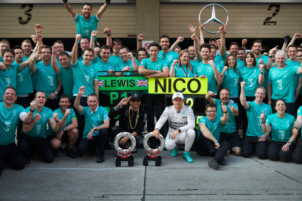 Shanghai International Circuit, Shanghai, China. Sunday 12 April 2015. Lewis Hamilton, Mercedes AMG, 1st Position, and Nico Rosberg, Mercedes AMG, 2nd Position, celebrate another victory with their team mates. World Copyright: Steve Etherington/LAT Photographic. ref: Digital Image SNE20557