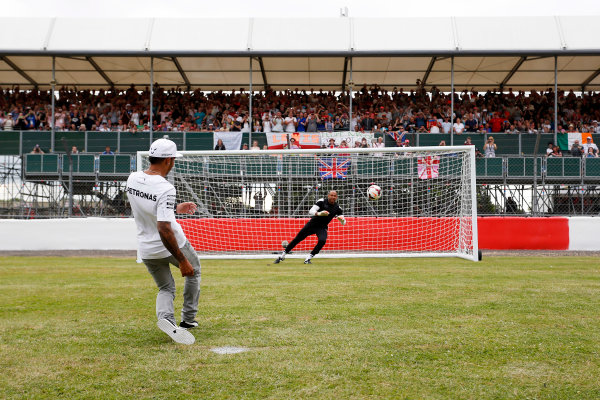 Silverstone, Northamptonshire, England. Thursday 3 July 2014. Lewis Hamilton, Mercedes AMG, takes some penalty kicks as part of a feature for Sky Sports F1. World Copyright: Andrew Ferraro/LAT Photographic. ref: Digital Image _FER9739