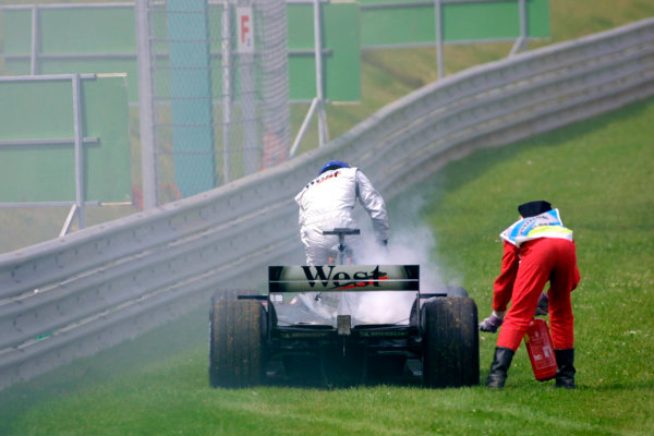 2002 Austrian Grand Prix - Race.A-1 Ring, Zeltweg, Austria. 12th May 2002Kimi Raikkonen, West McLaren Mercedes MP4/17, retires from the race.World Copyright: PicMe/LATref: Digital Image Only