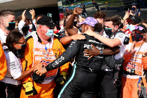 Sir Lewis Hamilton, Mercedes, is greeted by his team in parc ferme