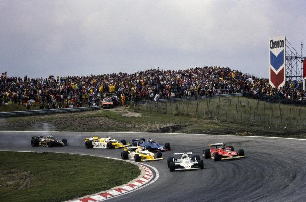 Alan Jones, Williams FW07 Ford leads Gilles Villeneuve, Ferrari 312T4 and Jean-Pierre Jabouille, Renault RS10.
