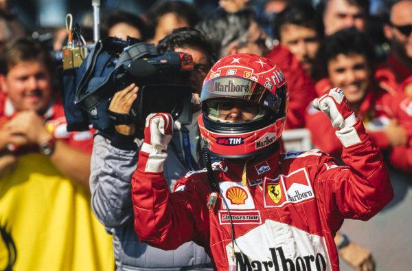 Michael Schumacher, 1st position, celebrates victory in Parc Ferme.
