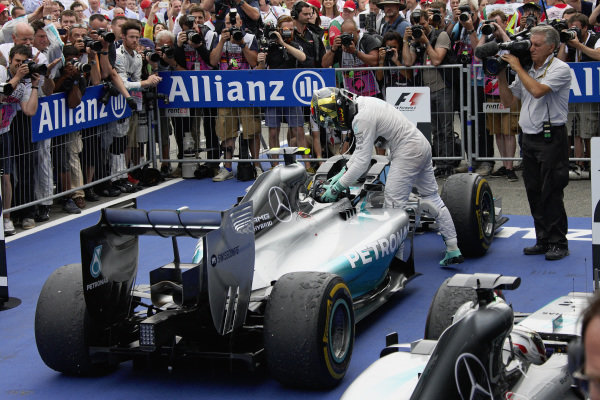 Nico Rosberg gets out of his Mercedes F1 W05 Hybrid in parc ferme.
