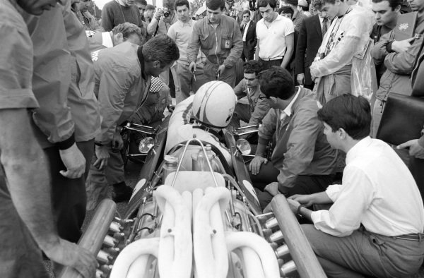 Mechanics work on Chris Amon's Ferrari 312.