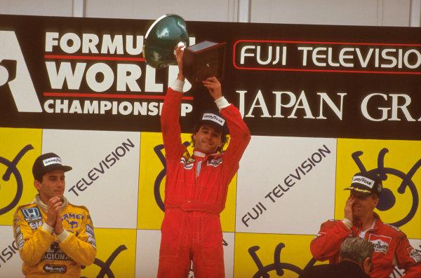 Suzuka, Japan.29/10-1/11 1987.Gerhard Berger (Ferrari) 1st position, Ayrton Senna (Team Lotus) 2nd position and Stefan Johansson (McLaren TAG Porsche) 3rd position on the podium.Ref-87 JAP 05.World Copyright - LAT Photographic