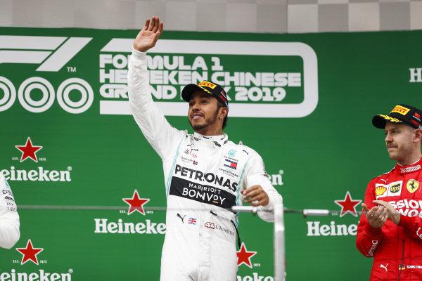 Lewis Hamilton, Mercedes AMG F1 celebrates on the podium with Sebastian Vettel, Ferrari