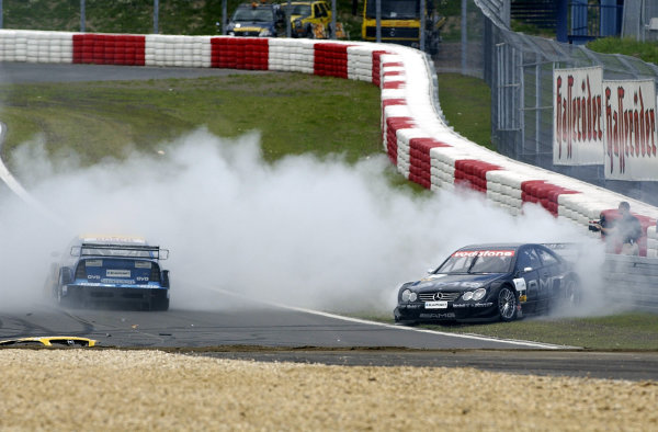 2002 DTM Championship Nurburgring, Germany. 2th - 4th August 2002. Jean Alesi (Mercedes CLK-DTM) spins into the tyre wall after colliding with Alain Menu (Opel Astra V8 Coupe), action.World Copyright: Andre Irlmeier/LAT Photographic