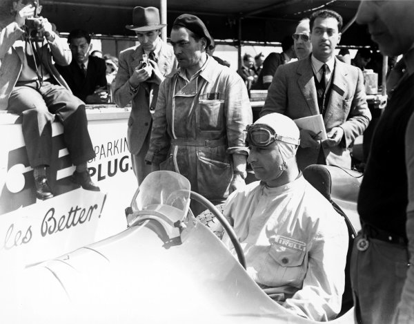 1950 British Grand Prix Silverstone, Great Britain. 13 May 1950 Juan Manuel Fangio (Alfa Romeo 158) at the first round of the new World Championship World Copyright: LAT Photographic.  Ref:  Autocar Glass Plate A098.