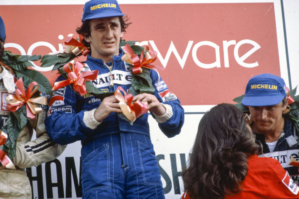 Alain Prost, 1st position, alongside René Arnoux, 3rd position, on the podium.