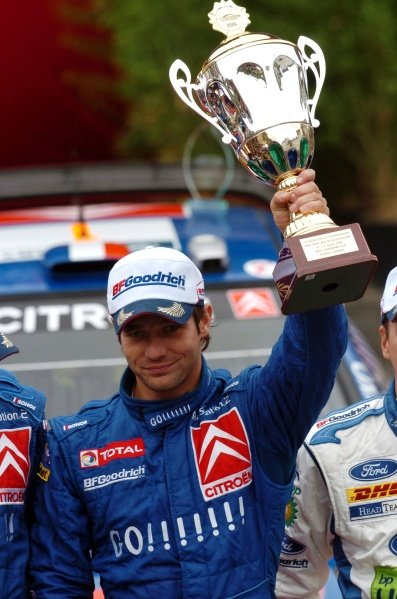 Sebastien Loeb (FRA) with the winner's trophy on the podium in Trier.