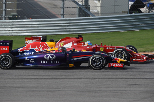 Sebastian Vettel (GER) Red Bull Racing RB10 and Fernando Alonso (ESP) Ferrari F14 T battle. Formula One World Championship, Rd17, United States Grand Prix, Race, Austin, Texas, USA, Sunday 2 November 2014. BEST IMAGE