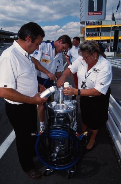 FIA stewards take an Elf fuel sample. German Grand Prix, Hockenheim, 25 July 1993