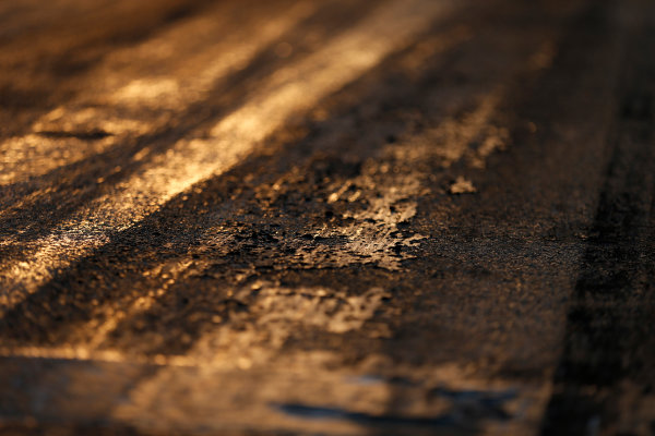 Hungaroring, Budapest, Hungary. Friday 24 July 2015. Track surface detail as the sun rises. World Copyright: Charles Coates/LAT Photographic ref: Digital Image _N7T6240