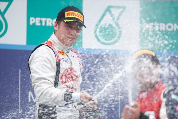 2013 GP2 Series. Round 1.  Sepang, Kuala Lumpur, Malaysia. 24th March 2013.  Sunday Race.  Stefano Coletti (MON, Rapax) celebrates his victory on the podium.  World Copyright: Alastair Staley/GP2 Series Media Service.  ref: _89P0666