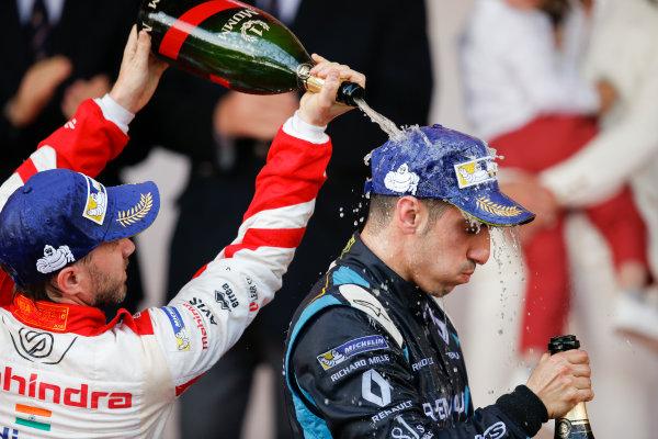 2016/2017 FIA Formula E Championship. Monte-Carlo, Monaco Saturday 13 May 2017. Sebastien Buemi (SUI), Renault e.Dams, Spark-Renault, Renault Z.E 16, sprays the champagne on the podium with Nick Heidfeld (GER), Mahindra Racing, Spark-Mahindra, Mahindra M3ELECTRO. Photo: Alastair Staley/LAT/Formula E ref: Digital Image _X0W1421